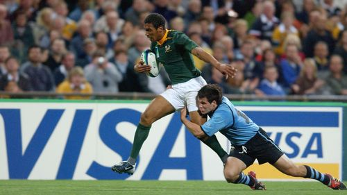 Try Savers: Joaquin Pastore puts in a try saver for Uruguay at RWC 2003