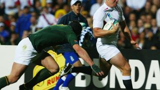Try Savers: Joe Van Niekerk tackles Tindle into touch at RWC 2003