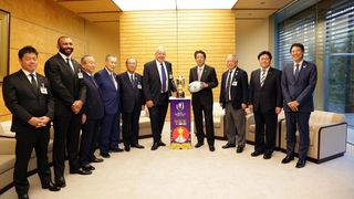 Japan's Prime Minister Shinzo Abe and World Rugby Chairman Sir Bill Beaumont