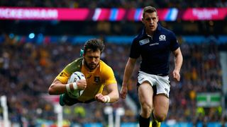 FLYING: Adam Ashley Cooper scores a try for Australia in the world cup semi-final win over Scotland in 2015