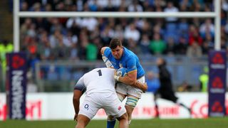 Sebastian Negri of Italy is tackled