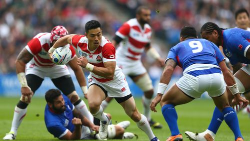Akihito Yamada of Japan breaks during the 2015 Rugby World Cup Pool B match between Samoa and Japan