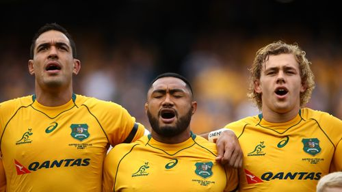 Rory Arnold, left, lines up with Australia team-mates Sekope Kepu and Ned Hanigan before an international Test against Scotland