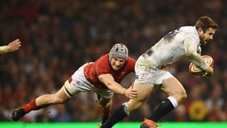 Jonathan Davies of Wales tackles Elliot Daly of England during the Guinness Six Nations match between Wales and England at Principality Stadium on February 23, 2019 in Cardiff, Wales
