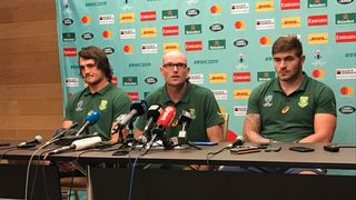 South Africa defence coach Jacques Nienaber (centre) at a media conference with lock Franco Mostert (left) and Malcolm Marx (right)