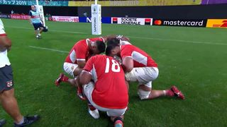 England and Tonga players share a moment on the pitch