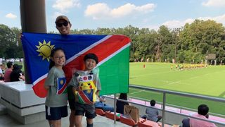 Namibia flag and schoolchildren
