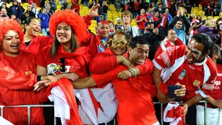 Tonga's Siale Piutau with fans after the win over France at RWC 2011