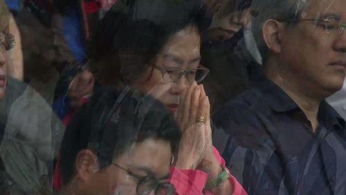 A moment of silence at Oita Stadium