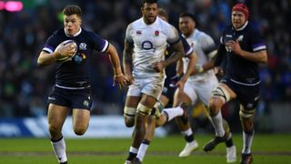 Huw Jones playing for Scotland against England in the 2018 Six Nations Championship