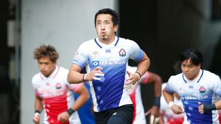 Photo of players running out at a Japan rugby test event