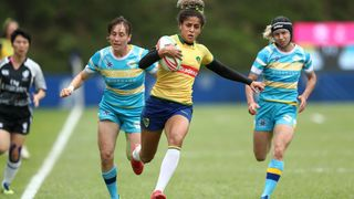 Photo of Brazil's Bianca Silva cutting through the Kazakhstan defense for a try on day one of the World Rugby Women's Sevens Series Qualifier in Hong Kong