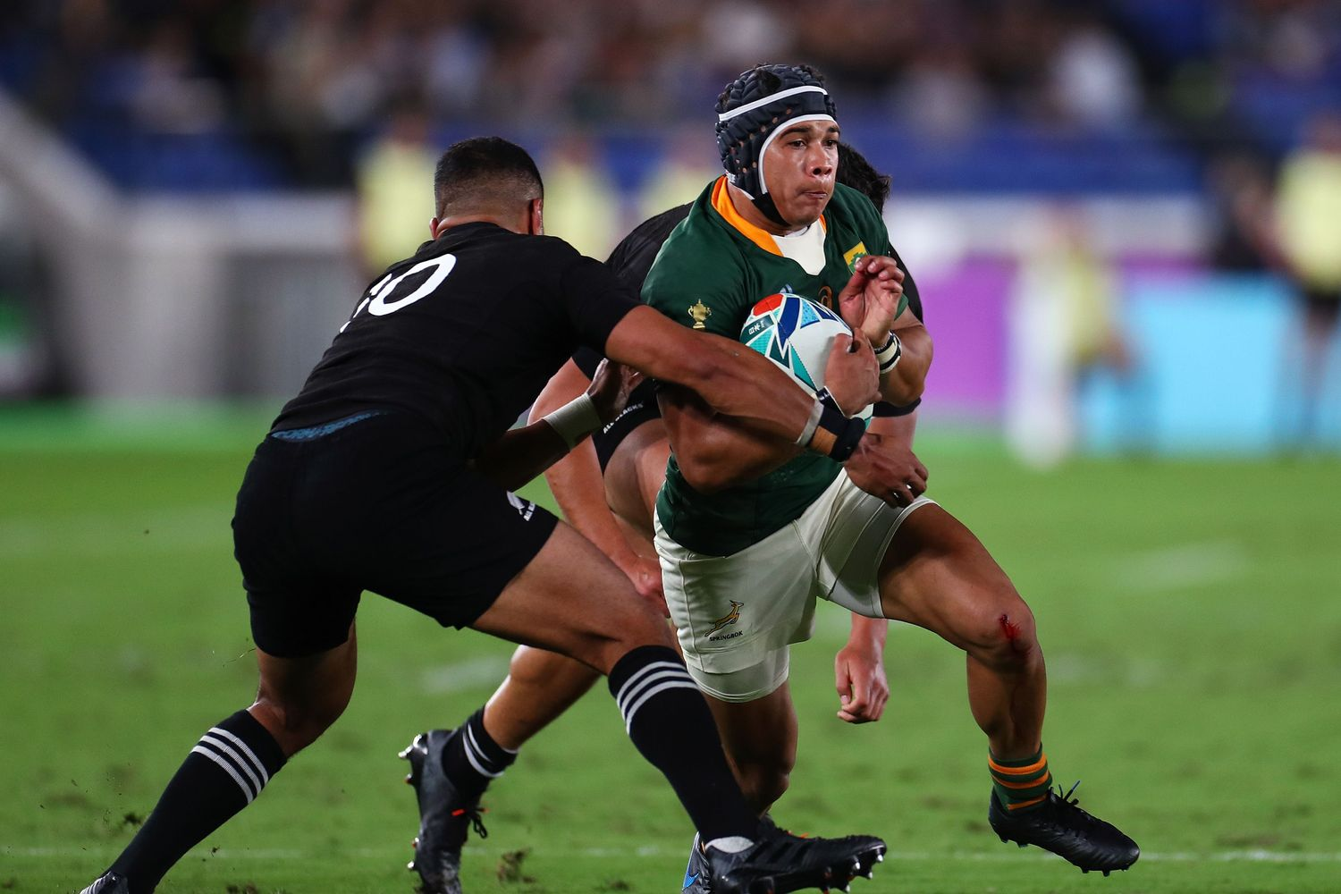 The South African Cheslin Kolbe fighting New Zealand.