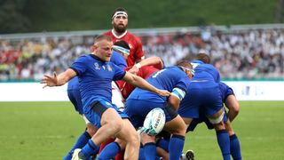 Italy scrum-half Callum Braley clears his lines against Canada