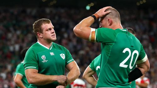 Ireland's dejected players following their defeat by Japan in Shizuoka