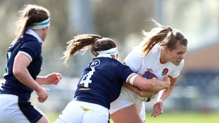 Photo of Zoe Aldcroft crashing through the tackle of Emma Wassell of Scotland during the Women's Six Nations match between England and Scotland