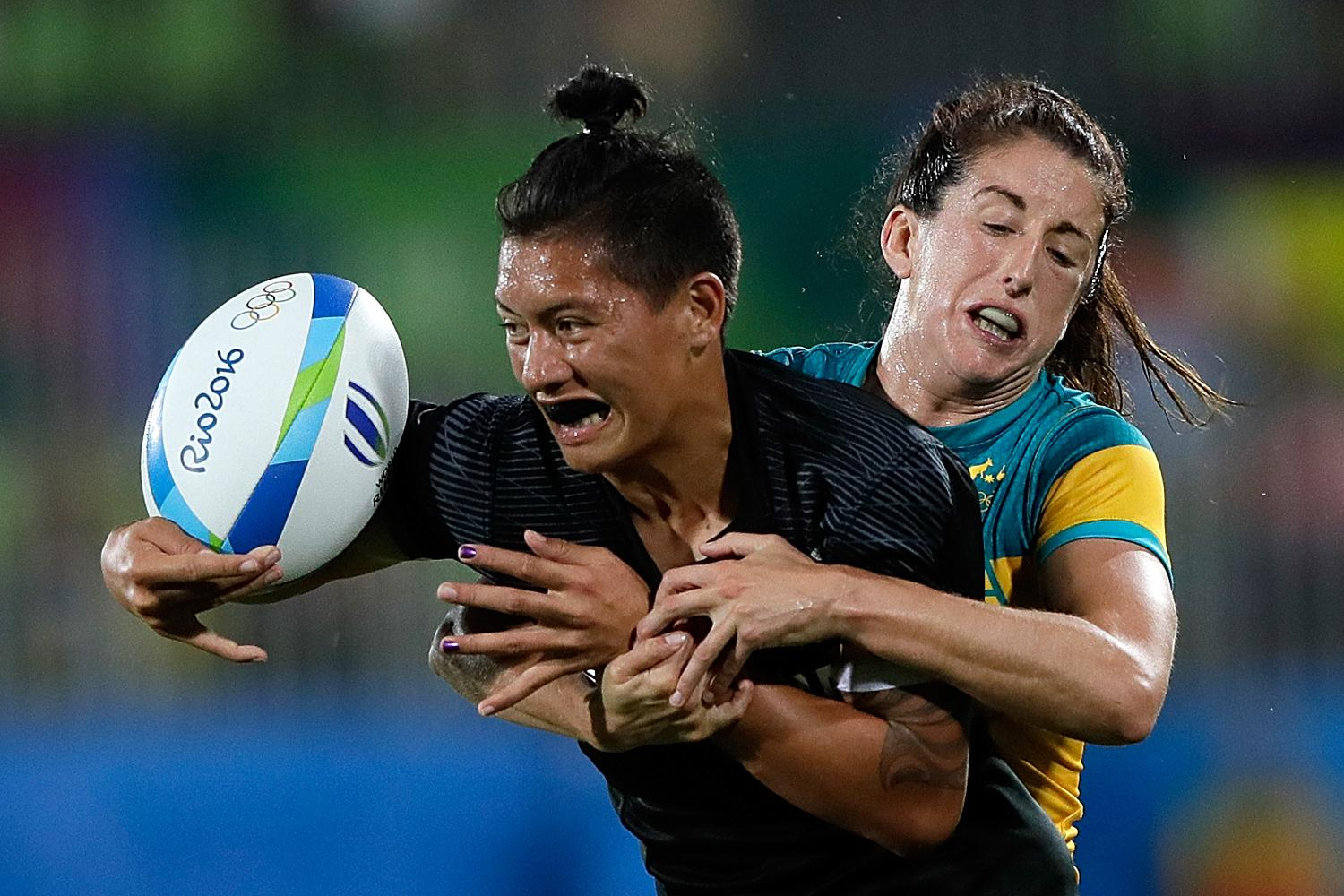 Gayle Broughton of New Zealand women's sevens team is tackled by Australia's Alicia Quirk