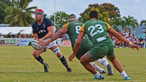 Hong Kong's Liam Slatem slices through Cook Islands defence